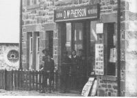 Duncan McPherson's shop and post office (now Saucy Mary's) with the Free Church in the background (the McPherson family lived at Sunnybank)