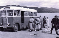 Portree bus collecting passengers from the ferry at Kyleakin. Note the newspapers being delivered and the man in the ferry uniform and wellingtons is Alistair Finlayson