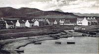 Circa 1910 - Kyleakin from Lump. Note the wooden pier built to service the mail boat from Kyle and Portree, also, cows on Corran, and the church looks as if it has 2 doors