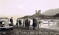 12th September 1933 - Duke and Duchess of York later to become King George VI  and Queen Elizabeth landing at Kyleakin. King George can be seen talking to the Customs Officer and possibly Major A D MacKinnon, Dunringell. Dr Hector MacLean the parish minister and Lord Alistair MacDonald talking to the Queen. Also in attendance were Lady Helen Graham and Lady Hermoine Cameron, if any one knows who the other people are, please let us know.  Note the Kyle/Kyleakin ferry launch - the