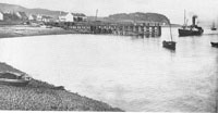 "Circa 1900 - The wooden pier and Kyleakin beach, and probably the ship ""Glencoe"" approaching the pier"