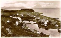 "Circa late 1930's. View of village from Cnoc na Errich at high tide with ""lots"" in the background."