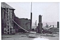 Around ferry office area following a fire in the 1930's.
