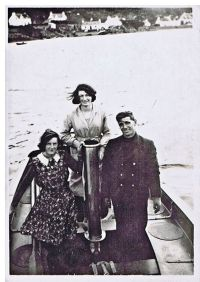 Left to right:  Isa Reid, Agnes Cameron on a launch (possibly tender to the Glen Strathallan which belonged to a Mr Cubbins and anchored in Loch Na Beiste) on the Obbe with uniformed man