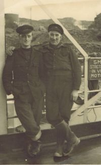 Circa 1954 – David MacKay on the left and John MacLaine (Johnny Mimac) on the ferry turntable at Kyle.