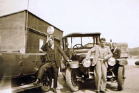 1934 - At Cameron's Petrol Pump and Ferry Office, unknown men - possibly drivers